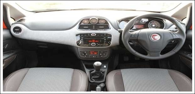 The front is packed with a leather wrapped three spoke steering wheel , keyless entry and other features