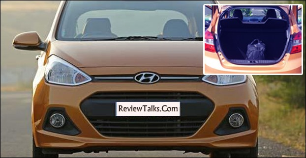 In base Hyundai Grand i10 model  , the body coloured door handles, tail gate and mirrors are absent  however its  256 litre of boot space and plenty of cup holders is a matter of some respite